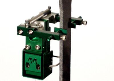 miniature_transverse_extensometer_mounted_on_a_fiber_reinforced_plastic_tensile_specimen-Model_3475-050T