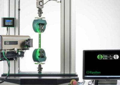 video extensometer with carbon fiber composite tensile specimen
